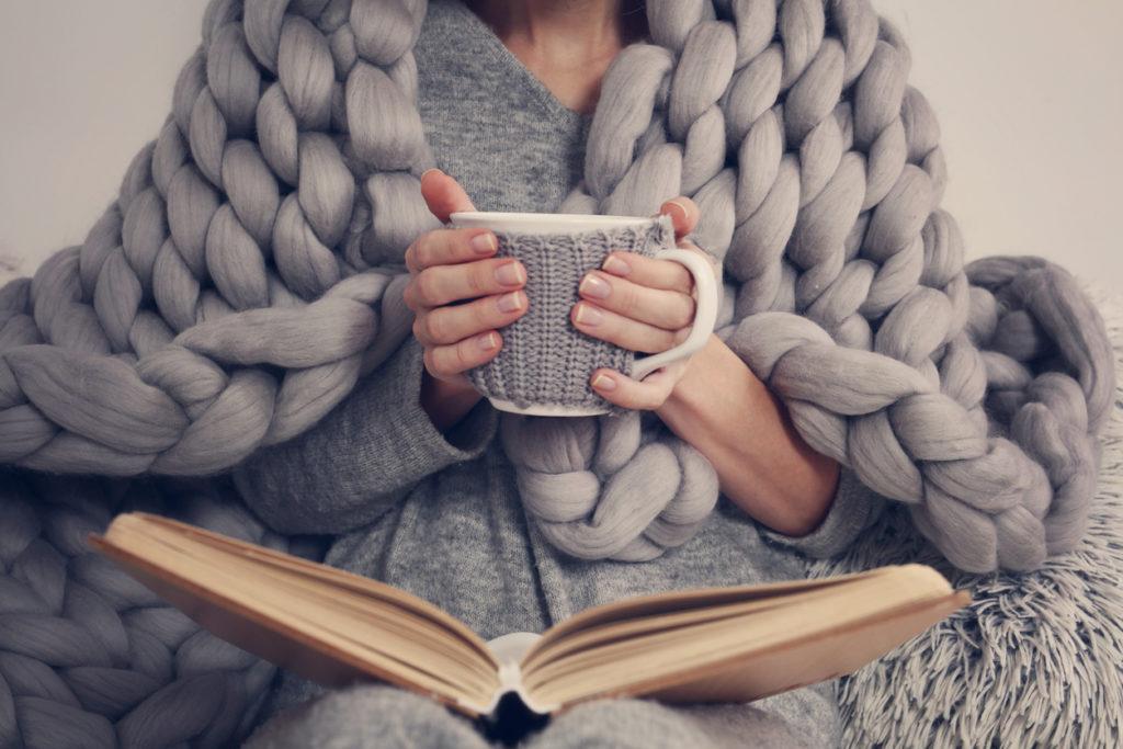 Cozy, Reading Photo Credit: ChesiireCat (iStock).